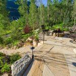 Vail-Mountain-Elegant-custom-stone-firepit-with-steelog-fire-flagstone-patio