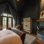 Arrowhead-master-suite-with-plaster-fireplce